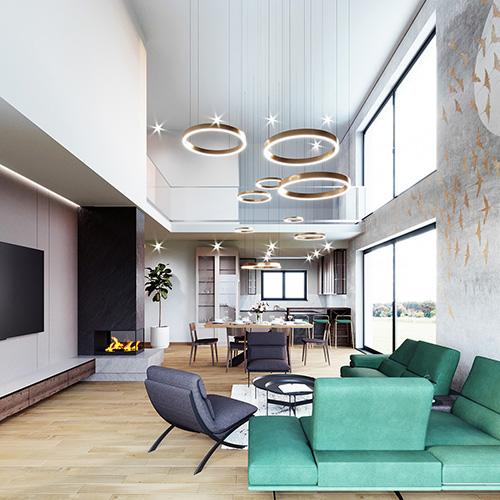 Projekt pokoju dziennego z zieloną kanapą i złotymi dodatkami. M2 Architektura architekt Katowice