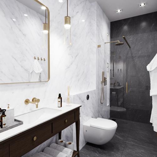 Projekt łazienki w hotelu ze stylizowaną szafką pod umywalką oraz marmurowymi płytkami.